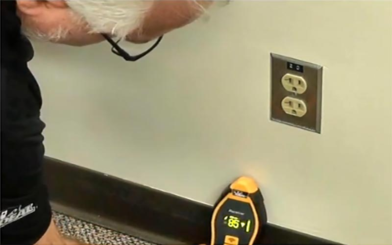 Man tracing wire in wall with IDEAL circuit tracer.